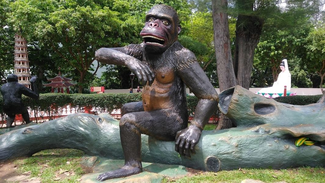 Picture of The Monkey Warrior sculpture in the gardens at at Haw Par Villa.