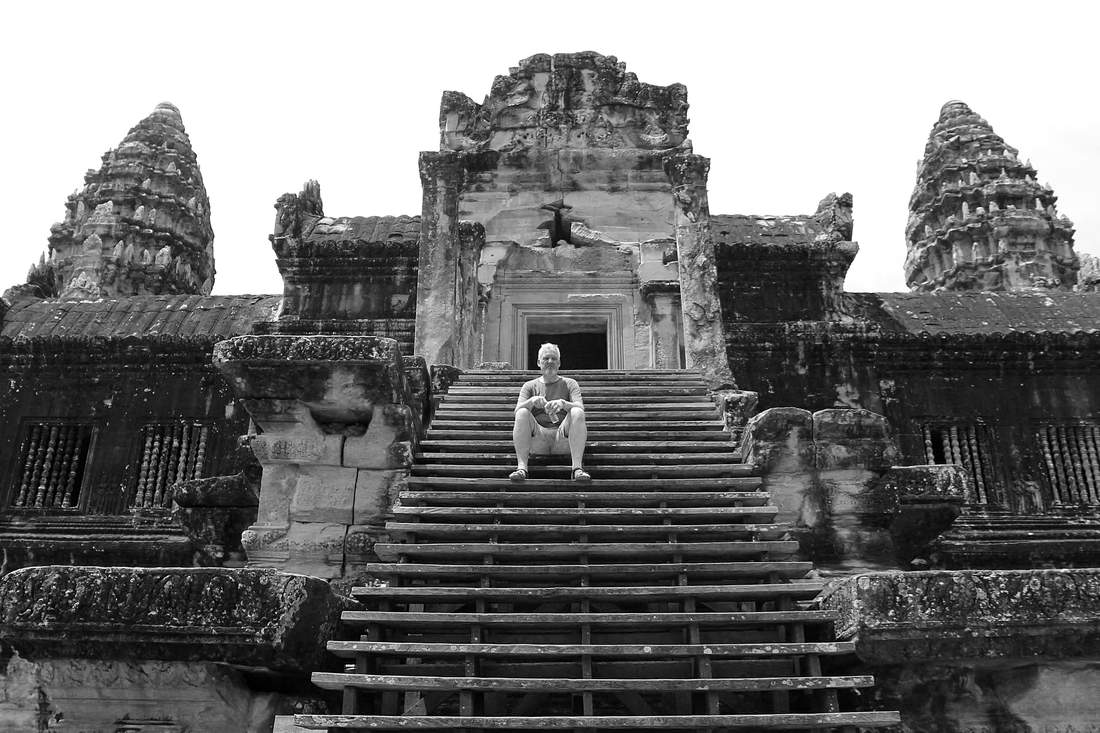 Nicolo on the steps of Angkor Wat in black and white