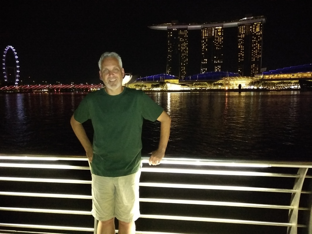 Picture of Nicolo in foreground and View of Marina Bay Sands in background.