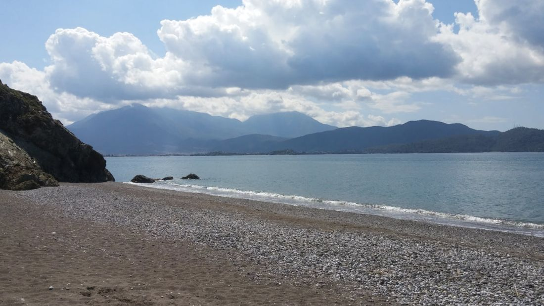 Picture of the beach with mountains in background.